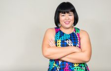 Studio shot of beautiful overweight Asian woman